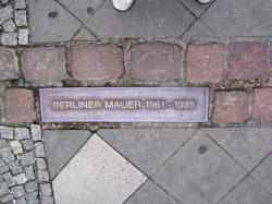 "A ""Berliner Mauer 1961–1989"" plaque near Checkpoint Charlie signifying where the wall stood"